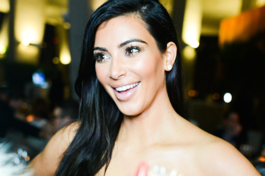 Kim Kardashian Jumps on a Trampoline in a Bikini